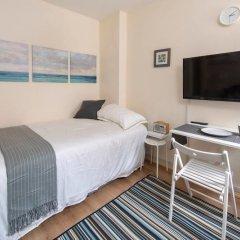 Отель Cosy Studio in Heart of West Didsbury Великобритания, Манчестер - отзывы, цены и фото номеров - забронировать отель Cosy Studio in Heart of West Didsbury онлайн комната для гостей