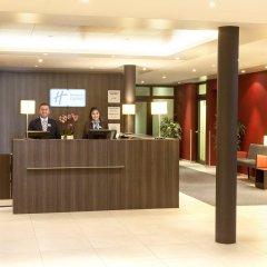 Отель Holiday Inn Express Zurich Airport Швейцария, Рюмланг - 1 отзыв об отеле, цены и фото номеров - забронировать отель Holiday Inn Express Zurich Airport онлайн интерьер отеля фото 3