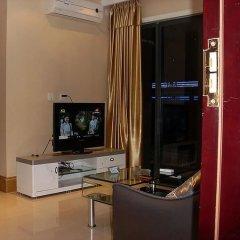 Отель Pinjing Guanghong Tianqi Apartment - Guangzhou Китай, Гуанчжоу - отзывы, цены и фото номеров - забронировать отель Pinjing Guanghong Tianqi Apartment - Guangzhou онлайн комната для гостей