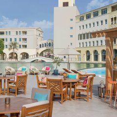 Отель Courtyard by Marriott Dubai Green Community бассейн фото 3