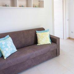 Апартаменты La Riviera apartment by Dimore in Sicily Сиракуза комната для гостей
