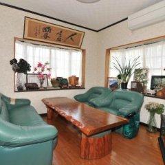 Отель Minshuku Yakusugi-sou Якусима комната для гостей фото 3