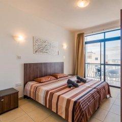 Отель Seashells Self Catering Apartment Мальта, Буджибба - отзывы, цены и фото номеров - забронировать отель Seashells Self Catering Apartment онлайн комната для гостей фото 3