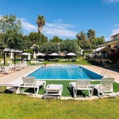 Отель Bungalows Papalús Испания, Льорет-де-Мар - отзывы, цены и фото номеров - забронировать отель Bungalows Papalús онлайн бассейн фото 3