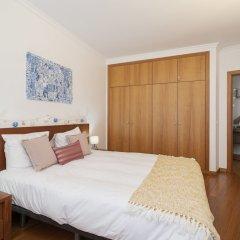 Отель Apartamento Lobo Marinho Португалия, Санта-Крус - отзывы, цены и фото номеров - забронировать отель Apartamento Lobo Marinho онлайн комната для гостей фото 2