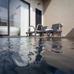Отель The Calm Resort & Spa бассейн фото 2