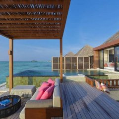 Отель Four Seasons Resort Maldives at Kuda Huraa балкон