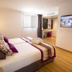 Grand Hotel Palladium Santa Eulalia del Rio комната для гостей фото 2