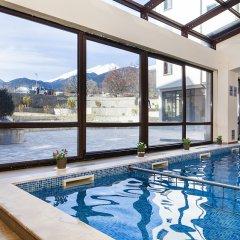 Отель St. George Ski & Holiday бассейн