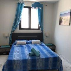 Отель Marsascala Sea View Luxury Apartment & Penthouse Мальта, Марсаскала - отзывы, цены и фото номеров - забронировать отель Marsascala Sea View Luxury Apartment & Penthouse онлайн комната для гостей фото 4
