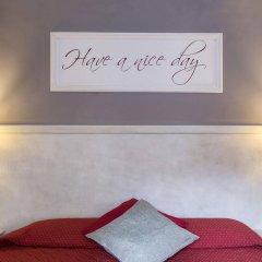 Отель Inn Rome Rooms & Suites сейф в номере
