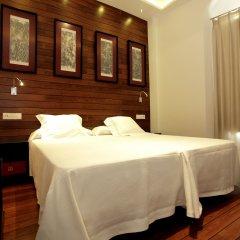 Отель Hostal el Alojado de Velarde комната для гостей