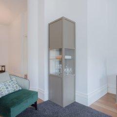 Апартаменты Liiiving - Aliados Luxury Apartments Порту сейф в номере