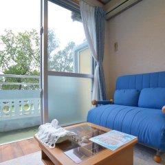 Отель Uminoie Painukaji Ириомоте комната для гостей фото 2
