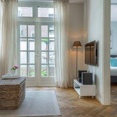 Апартаменты Nieuwmarkt Waag apartments комната для гостей фото 5