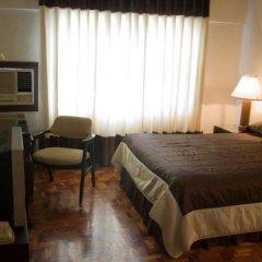 Отель El Rico Suites Филиппины, Макати - отзывы, цены и фото номеров - забронировать отель El Rico Suites онлайн удобства в номере фото 2