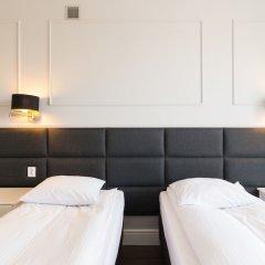 Отель Executive 3 Bedroom Apartament by Your F Польша, Варшава - отзывы, цены и фото номеров - забронировать отель Executive 3 Bedroom Apartament by Your F онлайн комната для гостей фото 5