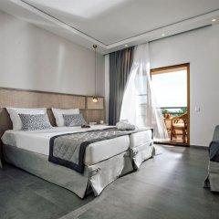 Possidi Holidays Resort & Suite Hotel комната для гостей