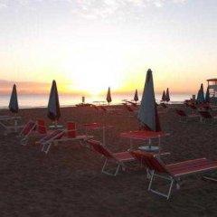 Hotel Amicizia Rimini пляж фото 2