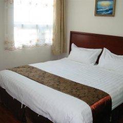 GreenTree Inn Taicang Baolong Square Hotel комната для гостей