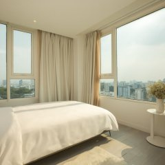 Отель M Suites by S Home Хошимин фото 4