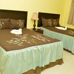 Отель Donway, A Jamaican Style Village Ямайка, Монтего-Бей - отзывы, цены и фото номеров - забронировать отель Donway, A Jamaican Style Village онлайн комната для гостей фото 3