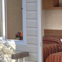 Отель Flaminio Village Bungalow Park Италия, Рим - 3 отзыва об отеле, цены и фото номеров - забронировать отель Flaminio Village Bungalow Park онлайн балкон