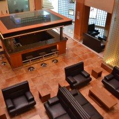 Hostalia Hotel Expo & Business Class интерьер отеля
