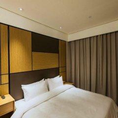 Отель JI Hotel Shanghai Hongqiao Transport Hub Linkong Zone Китай, Шанхай - отзывы, цены и фото номеров - забронировать отель JI Hotel Shanghai Hongqiao Transport Hub Linkong Zone онлайн комната для гостей