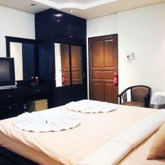 Апартаменты At Home Executive Apartment Паттайя комната для гостей фото 2