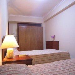 Апартаменты Saigon Court Serviced Apartment Хошимин сейф в номере