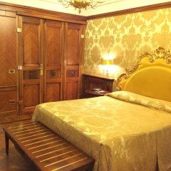 Отель Canaletto Suites комната для гостей