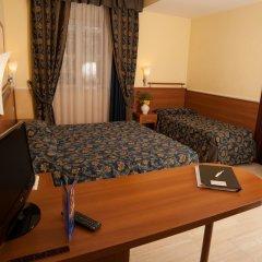 Отель WINDROSE Рим сейф в номере