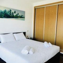 Отель Modern beach view townhouse комната для гостей