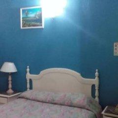 Отель Village Hotel Ямайка, Очо-Риос - отзывы, цены и фото номеров - забронировать отель Village Hotel онлайн комната для гостей фото 3