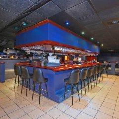 Отель Magnuson Grand Columbus North США, Колумбус - отзывы, цены и фото номеров - забронировать отель Magnuson Grand Columbus North онлайн гостиничный бар