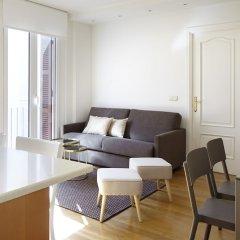 Апартаменты Moneo Apartment by FeelFree Rentals комната для гостей