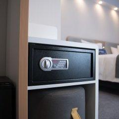 Отель Holiday Inn Express Moscow Baumanskaya Москва сейф в номере