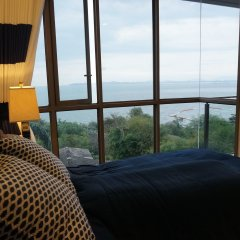 Отель Baan Plai Haad Beachfront Condominium Паттайя комната для гостей фото 5
