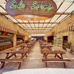 Sueno Hotels Beach Side Турция, Сиде - отзывы, цены и фото номеров - забронировать отель Sueno Hotels Beach Side онлайн интерьер отеля