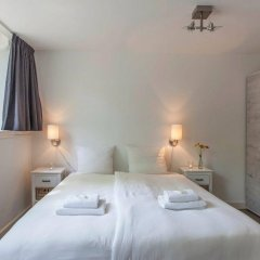 Апартаменты Tulip Apartment A комната для гостей