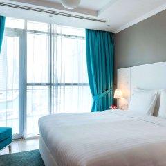 Отель Jannah Marina Bay Suites комната для гостей
