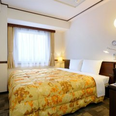 Отель Toyoko Inn Tokyo-eki Yaesu Kita-guchi комната для гостей