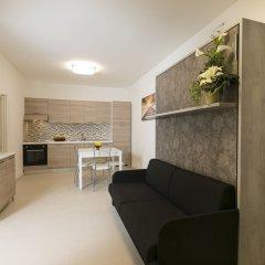 Отель Riva Azzurra Residence Римини комната для гостей