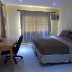 Mikagn Hotel and Suites Ибадан сейф в номере