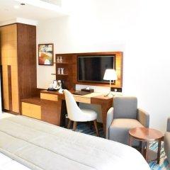 Отель Golden Tulip Al Thanyah удобства в номере фото 2
