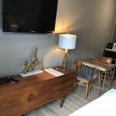 Апартаменты SleepWell Apartments удобства в номере