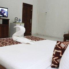 Отель Coconut Grove Beach Resort комната для гостей