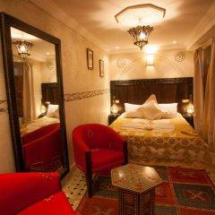 Отель Dar Ikalimo Marrakech комната для гостей