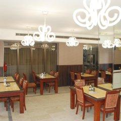 Отель Al Buhaira Hotel Apartments ОАЭ, Шарджа - отзывы, цены и фото номеров - забронировать отель Al Buhaira Hotel Apartments онлайн питание